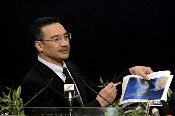 Breakthrough: Malaysias Defense Minister and acting Transport Minister Hishammuddin Hussein shows a printout of the latest satellite image of objects that might be from the missing Malaysia Airlines plane